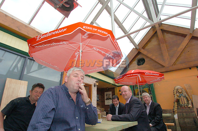 Tony ward owner of Reds bar in Drogheda havinf a smoke in the bar which now has no roof..Photo Fran Caffrey Newsfile.ie..This Picture has been sent to you by Newsfile Ltd..The Studio,.Millmount Abbey,.Drogheda,.Co. Meath,.Ireland..Tel: +353(0)41-9871240.Fax: +353(0)41-9871260.ISDN: +353(0)41-9871010.www.newsfile.ie..general email: pictures@newsfile.ie