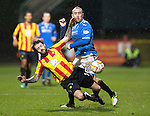 Partick Thistle v St Johnstone....21.01.14   SPFL<br /> Jordan McMillan is tackled by Lee Croft<br /> Picture by Graeme Hart.<br /> Copyright Perthshire Picture Agency<br /> Tel: 01738 623350  Mobile: 07990 594431