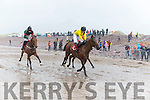 Horse's and jockeys rinding through the gale force wind at the Rossbeigh races on Sunday