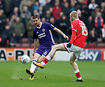 Chris Basham of Sheffield Utd passes past Oliver McBurnie  of Barnsley during the championship match at the Oakwell Stadium, Barnsley. Picture date 7th April 2018. Picture credit should read: Simon Bellis/Sportimage
