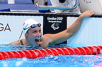 PICTURE BY ALEX BROADWAY /SWPIX.COM - 2012 London Paralympic Games - Day Seven - Swimming, Aquatic Centre, Olympic Park, London, England - 05/09/12 - Elodie Lorandi of France reacts after winning the Women's 400m Freestyle S10 Final.