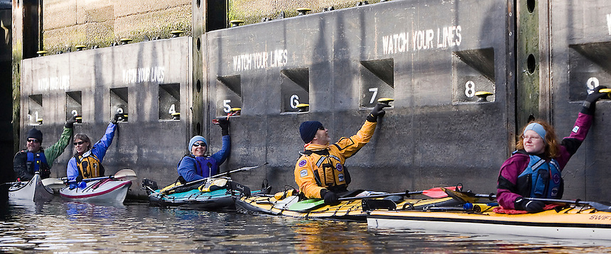 From the right, Washington Water Trails outreach director Sara Krueger, Reed Waite of the Washington Water Trails Association, wife Tina Waite, Lorna Johnston of Kirkland, and Ed Matkovick of Issaquah hold on as the water rises in Ballard Locks in Seattle Saturday Dec. 8, 2007.