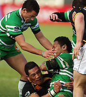 Wellington prop Anthony Perenise tackles Johnny Leota as Aaron Cruden (left) joins the action during the Air NZ Cup preseason match between Manawatu Turbos and Wellington Lions at FMG Stadium, Palmerston North, New Zealand on Friday, 17 July 2009. Photo: Dave Lintott / lintottphoto.co.nz