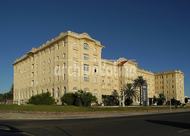 The Argentino Hotel in Piriapolis, a resort dedicated to thalassotherapy in Uruguay, is one of the highlights of the legacy of Francisco Piria, an Italian immigrant that started as a young dreamer with no cent in his pockets and become one of the richest man of this South American country. Born in 1848, Piria began a small auction shop in Montevideo market, but soon lost almost everything due a fire destroying the place. Restarted with a clothes shop in downtown, He did well and jumped to buy lands, develop a district, and sell the parcels. It´s believed that he created a hundred neighborhoods of what is the modern  Montevideo.<br /> In 1890 he bought a large piece of land in the East of the shore, 96 kilometers from Montevideo, and created an entire city, later known as Piriapolis where he built the Argentino Hotel. Devoted to alchemy and masonry, Piria left signs of his belives in all his buildings, including huge and historical ones like the now seat of Justice Supreme Court of Uruguay.<br /> Piria tried to made a version of Piriapolis in the opposite shore of the Rio de la Plata, in the Argentine city of Ensenada. Local  bureaucracy created so many barriers  that , even if he bought the land and built a castle, was forced  to abandon the project.<br /> Never feeling defeated, Piria inaugurated the magnificient Argentino Hotel in 1930, few years before dying at the age of 98. <br /> His success as businessman never translated as good luck in politics. He tried several Uruguay political parties , he founded his own party Democratic Union. In his  only presidential candidacy  in 1919 Piria got just 600 votes.