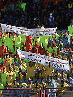 Young men sporting uniform track suites wave welcome banners to before the start of the FIFA Under 20 World Cup Group C Match between the United States and Germany at the  on September 26, 2009 at the Mubarak Stadium in Suez, Egypt. The US lost to Germany 3-0.