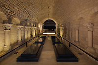 Funerary slabs in the Bourbon vault or Hilduin chapel, with walls and capitals dating to the 12th century, in the crypt of the Basilique Saint-Denis, Paris, France. This remains interred in this vault include Louis XVI, Marie Antoinette, Louis XVIII and Louis VII. The basilica is a large medieval 12th century Gothic abbey church and burial site of French kings from 10th - 18th centuries. Picture by Manuel Cohen