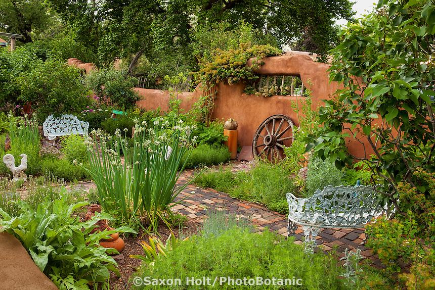 New Mexico herb garden edible landscape with rustic wagon wheel; Elspeth Bobbs Garden