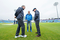 Picture by Allan McKenzie/SWpix.com - 13/04/2018 - Cricket - Specsavers County Championship - Yorkshire County Cricket Club v Essex County Cricket Club - Emerald Headingley Stadium, Leeds, England - Umpires Richard Illingworth and Ian Gould test the outfield at Headingley as groundsman Andy Foggarty looks on before abandoning play on the opening day of the Specsavers County Championship.