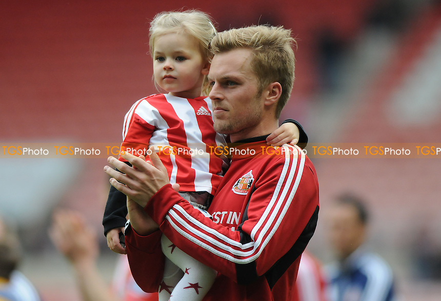 Sunderland's Sebastian Larsson on the lap of honour after the final whistle - Sunderland vs Southampton - Barclays Premier League Football at The Stadium of Light, Sunderland, Tyne & Wear - 12/05/13 - MANDATORY CREDIT: Steven White/TGSPHOTO - Self billing applies where appropriate - 0845 094 6026 - contact@tgsphoto.co.uk - NO UNPAID USE