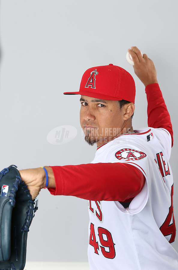 Feb. 21, 2013; Tempe, AZ, USA: Los Angeles Angels pitcher Ernesto Frieri poses for a portrait during photo day at Tempe Diablo Stadium. Mandatory Credit: Mark J. Rebilas-