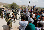 Palestinian protesters take part during a demonstration against the closure of a road since 18 years by the Israeli army in the West Bank village of Khirbat Qalqas, south of Hebron, on September 7, 2018. Photo by Wisam Hashlamoun