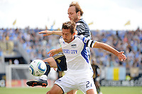 Justin Mapp (22)  of the Philadelphia Union tries to play the ball around Davy Arnaud (22) of the Kansas City Wizards during a Major League Soccer (MLS) match at PPL Park in Chester, PA, on September 04, 2010.