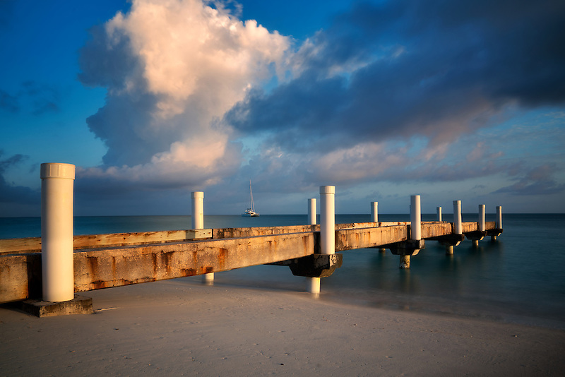Pier and sunrise with boat. Turks and Caicos. Providenciales
