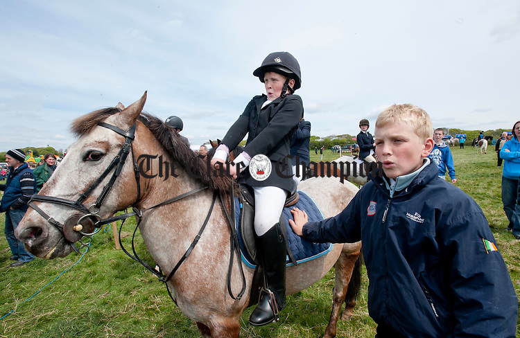 Des and Brian Fitzgerald from Limerick look on as one of the competitors is thrown from their horse during the Newmarket Show at the weekend. Photograph by Declan Monaghan