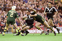 Picture by Shaun Flannery\SWpix.com - 25/11/00 - Rugby League World Cup Final 2000 - Australia v New Zealand, Old Trafford, Manchester, England - Australia's Adam Macdougall halts the progress of New Zealands Tonie Carroll.