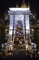 """UNGARN, 11.03.2013. Budapest - I. Bezirk. Am Tag der Verabschiedung des 4. Aenderungspakets zur neuen Verfassung, das effektiv das Ende des Rechtsstaates bedeutet, demonstrieren Studenten und Opposition zu Tausenden auf der Budaer Burg am Amtssitz des Staatspraesidenten János Áder. Danach ziehen sie in die Stadt, an der Spitze das """"Studentennetzwerk"""" HaHa (Hallgatói Hálozat). HIer auf der Kettenbruecke.   On the day parliament passes the 4th amendment to the new constitution, effectively eliminating the rule of law, thousands of students and outraged citizens demonstrate on the Buda castle hill close to the residence of state president Janos Ader. Afterwards they march downtown, headed by the """"Students' network"""" HaHa. Here on the chain bridge.  © Martin Fejer/EST&OST"""