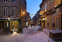 Houses and shops in the snow in the evening, in the Petit Champlain district of Vieux-Quebec, or the old town of Quebec City, Quebec, Canada. The area is one of the oldest in North America and is named after Samuel de Champlain, who founded Quebec City in 1608. The Historic District of Old Quebec is listed as a UNESCO World Heritage Site. Picture by Manuel Cohen