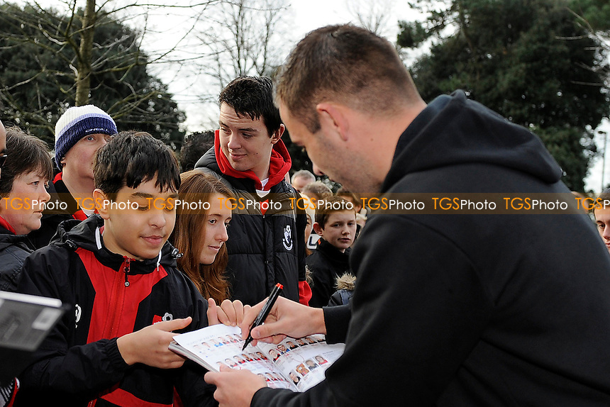 Steve Cook of AFC Bournemouth signs autographs - AFC Bournemouth vs Liverpool - FA Cup 4th Round Football at the Goldsands Stadium, Bournemouth, Dorset - 25/01/14 - MANDATORY CREDIT: Denis Murphy/TGSPHOTO - Self billing applies where appropriate - 0845 094 6026 - contact@tgsphoto.co.uk - NO UNPAID USE