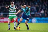 Luke O'Nien of Wycombe Wanderers & Ben Whitfield of Yeovil Town during the Sky Bet League 2 match between Wycombe Wanderers and Yeovil Town at Adams Park, High Wycombe, England on 14 January 2017. Photo by Andy Rowland / PRiME Media Images.