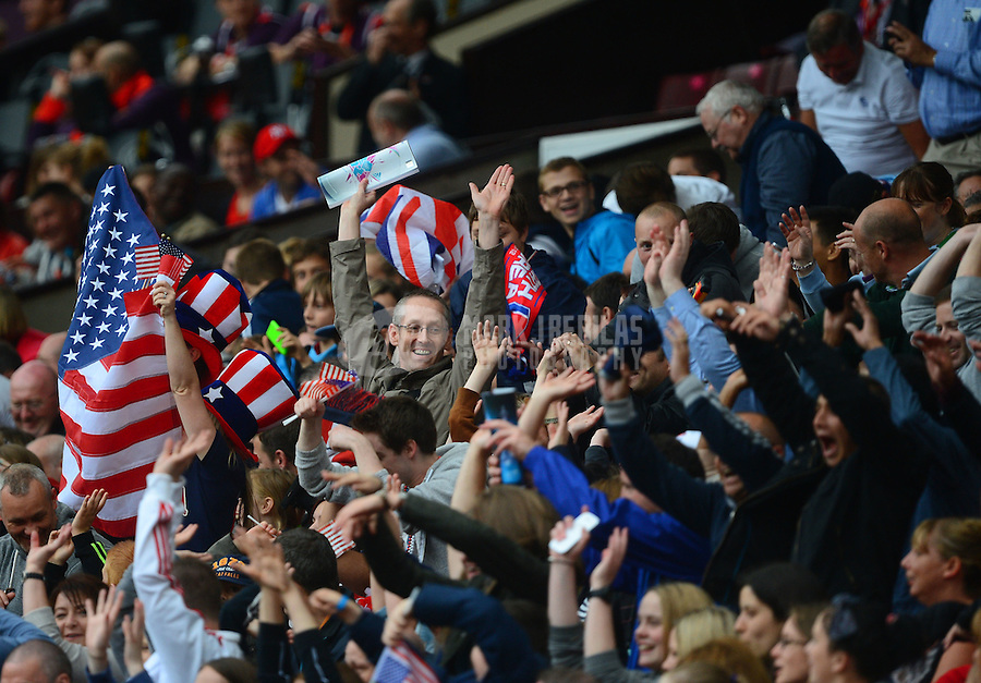 Jul 31, 2012; Manchester , United Kingdom; USA fans in the crowd wave American flags against North Korea during the women's preliminary round in the London 2012 Olympic Games at Old Trafford. USA defeated North Korea 1-0. Mandatory Credit: Mark J. Rebilas-USA TODAY Sports