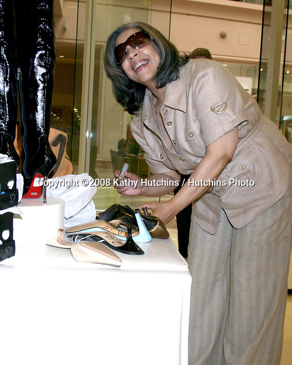 "Patti Austin autographs shoes she donated to ""Clothes Off Our Backs"" as the Carmen Steffens store hosts the  ""Divas Simply Singing"" ladies at the Carmen Steffens Store at the Westfield Fahion Square Mall, in Sherman Oaks,  CA on.October 9, 2008.©2008 Kathy Hutchins / Hutchins Photo....                ."