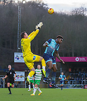Anthony Stewart of Wycombe Wanderers in up against Goalkeeper Artur Krysiak of Yeovil Town during the Sky Bet League 2 match between Wycombe Wanderers and Yeovil Town at Adams Park, High Wycombe, England on 14 January 2017. Photo by Andy Rowland / PRiME Media Images.