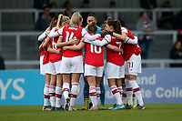 Arsenal players huddle during Arsenal Women vs Liverpool Women, Barclays FA Women's Super League Football at Meadow Park on 24th November 2019