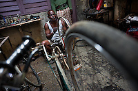 A Cuban service man fixes a bike wheel in the bicycle repair shop in Havana, Cuba, 10 February 2011.