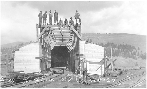 West end of snowshed as reconstructed, crew standing on roof beam.<br /> D&amp;RG  Cumbres, CO  Taken by Lively, Charles R. - 1922