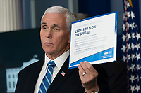 United States Vice President Mike Pence holds a chart as he speaks during a news briefing by members of the Coronavirus Task Force at the White House in Washington, DC on Monday, March 23, 2020.<br /> Credit: Chris Kleponis / Pool via CNP/AdMedia