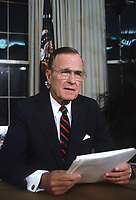 Washington DC., USA, September 27, 1991<br /> President George  H.W. Bush gives televised speech from the Oval Office on Nuclear Arms Reduction. Bush announced a raft of unilateral initiatives to limit and reduce the U.S. tactical nuclear weapons arsenal. (1) withdraw to the United States all ground-launched short-range weapons deployed overseas and destroy them along with existing U.S. Stockpiles of the same weapons: and (2) cease deployment of tactical nuclear weapons on surface ships, attack submarines, and land-based naval aircraft during &quot;normal circumstances&quot;. Implicitly, the United States reserved the right to redeploy these arms in a crisis. Credit: Mark Reinstein/MediaPunch