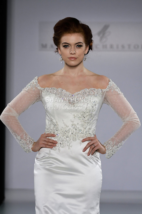 Model walks runway in an Eleanor wedding dress from the Matthew Christopher Couture Spring 2013 collection, at the Couture Show, during New York Bridal Fashion Week Spring 2013.