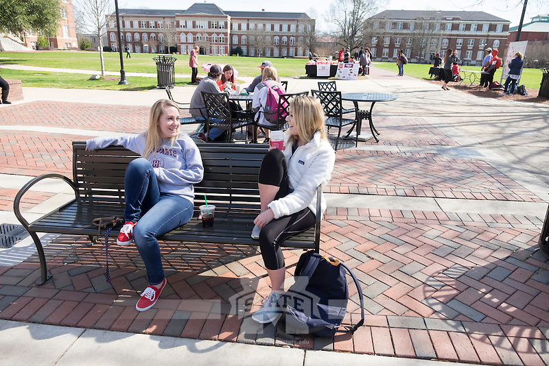 Students talking on Colvard Plaza bench in between classes. Alli Adams (L) and Ashlyn Jeffries.<br />  (photo by Megan Bean / &copy; Mississippi State University)