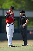 Hickory Crawdads manager Matt Hagan (39) discusses a call with umpire Jennifer Pawol during the game against the Lakewood BlueClaws at L.P. Frans Stadium on April 28, 2019 in Hickory, North Carolina. The Crawdads defeated the BlueClaws 10-3. (Brian Westerholt/Four Seam Images)
