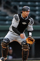 Catcher Drew Fisher (8) of the USC Upstate Spartans waits for a throw from the outfield in a game against the Furman University Paladins on Tuesday, March 4, 2013, at Fluor Field at the West End in Greenville, South Carolina. Furman won, 13-1. (Tom Priddy/Four Seam Images)