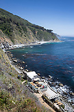 USA, California, Big Sur, Esalen, the hot spring baths and bath house at the Esalen Institute rest above the Pacific Ocean