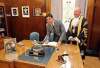 Pictured: Chris Coleman (L) signs the visitors' book with Lord Mayor for Swansea Councillor David Hopkins Thursday 20 October 2016<br />