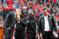 From left: Quarterbacks Cardale Jones, Braxton Miller and J.T. Barrett take the stage with head coach Urban Meyer during the Ohio State Football National Championship Celebration at Ohio Stadium, Saturday morning, January 24, 2015. More than 40 thousand fans packed the lower stands in the stadium to celebrate the National Championship win with the football team. (The Columbus Dispatch / Eamon Queeney)