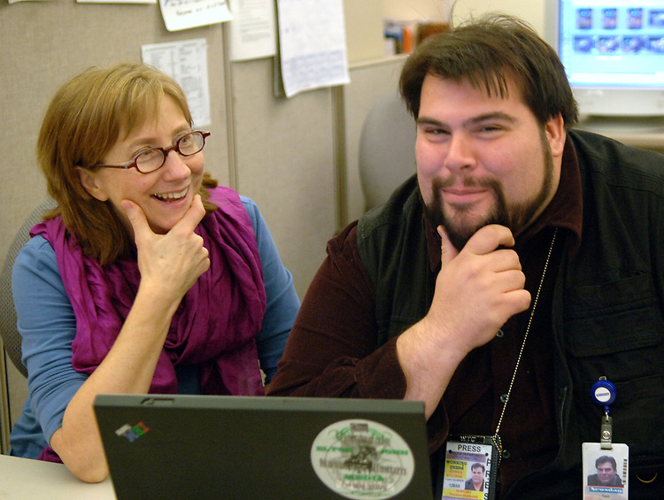 Rebecca Cooney and Tom Ferrara editing at Newsday Photo Dept in Melville on Tuesday November 14, 2006. (Photo Copyright Jim Peppler 2006).
