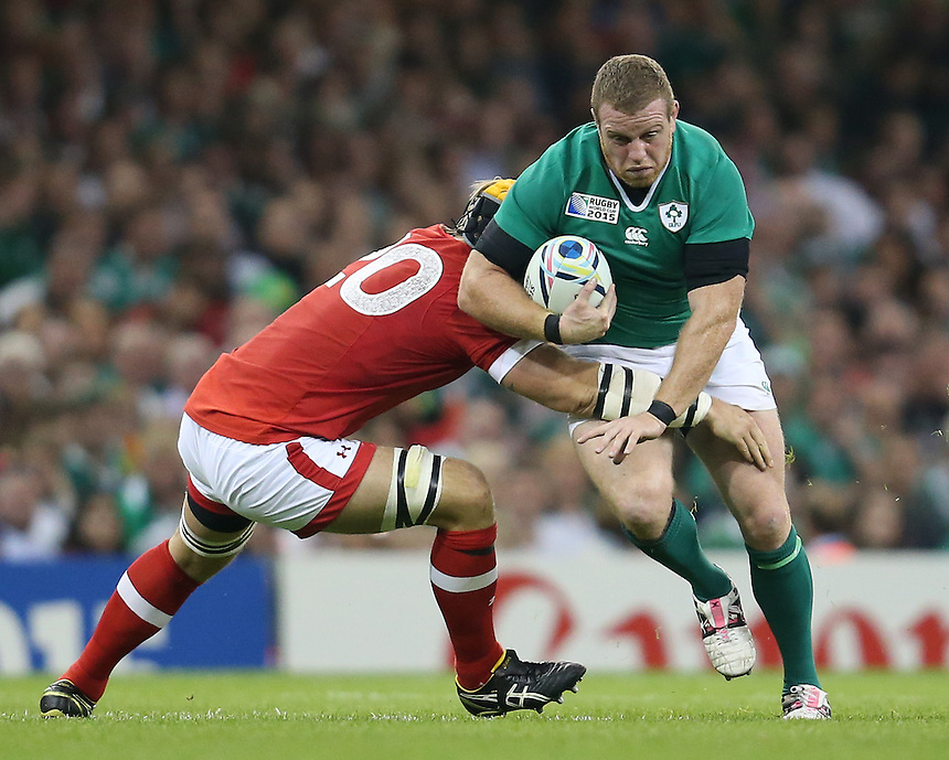 Ireland's Sean Cronin takes on Canada's Richard Thorpe<br /> <br /> Photographer Ian Cook/CameraSport<br /> <br /> Rugby Union - 2015 Rugby World Cup - Canada v Ireland - Saturday 19th September 2015 - Millennium Stadium - Cardiff<br /> <br /> &copy; CameraSport - 43 Linden Ave. Countesthorpe. Leicester. England. LE8 5PG - Tel: +44 (0) 116 277 4147 - admin@camerasport.com - www.camerasport.com