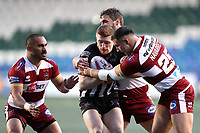 Picture by Paul Greenwood/SWpix.com - 27/04/2018 - Rugby League - Betfred Super League - Widnes Vikings v Wigan Warriors - Select Security Stadium, Widnes, England - Ed Chamberlain of Widnes Vikings is tackled by Sean O'Loughlin and Romain Navarrete of Wigan Warriors