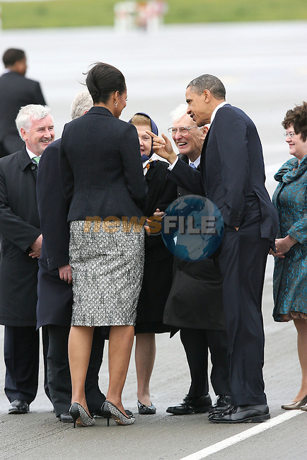 23/5/2011 .President of the United States of America Barack Obama and First Lady Michelle Obama pictured at Dublin Airport as they talk to American Ambassador Dan Rooney in Dublin on their Visit to Ireland .Picture: Maxwells/ www.newsfile.ie (POOL).