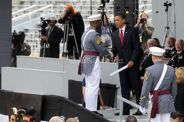 U.S. President Barack Obama greets class president Arron Conley  during graduation ceremonies at the United States Military Academy at West Point in West Point, New York. May 22, 2010.Credit: Dennis Van Tine/MediaPunch