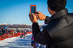 A man taking photos with his Smartphone. Charley Bejna starting Iditarod 2014, Willow, Southcentral Alaska, Winter.