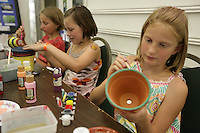 Right to left- Faith Pratt,  Mary Knibbe, 10, and Katelyn Fullner, paint pots. ..August 19, 2009. PHOTO BY MERYL SCHENKER ..