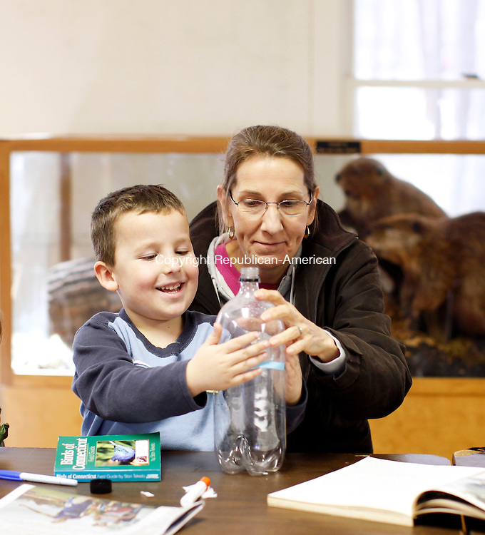 Litchfield, CT- 14, November 2010-111410CM01 Sean Leifert, 5, of Sharon and his aunt, Martha Lecko, of Torrington construct a bird feeder out of a plastic bottle Sunday afternoon inside the Mott Van Winkle classroom at the White Memorial Foundation in Litchfield.  Cynthia Phipps, the Litchfield Hills Junior Audubon Chairperson, instructed the class.  Christopher Massa Republican-American