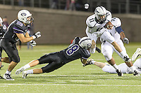 McNeil's quarterback Hayden Cooper tries to escape a tackle by Cedar Ridge's Spencer Engelke Thursday at Kelly Reeves Athletic Complex.  (LOURDES M SHOAF for Round Rock Leader)