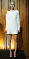 """ODILON FALL 2012<br /> """"#OSC830 WHITE LONG SLEEVE MINI DRESS WITH SATIN EMBROIDERED CUFF AND HEM DETAIL, OPEN BACK AND MAGNETIC CLOSURE"""""""