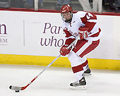 Ben Grotting 14 of the University of Wisconsin moves the puck. The Boston College Eagles defeated the University of Wisconsin Badgers 3-0 on Friday, October 27, 2006, at the Kohl Center in Madison, Wisconsin in their first meeting since the 2006 Frozen Four Final which Wisconsin won 2-1 to take the national championship.<br />