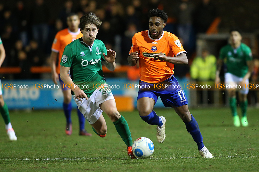 Reece Hall-Johnson of Braintree Town evades Alex Woodyard of Lincoln City during Braintree Town vs Lincoln City, Vanarama National League Football at the IronmongeryDirect Stadium on 7th March 2017